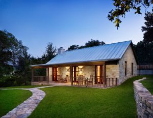 blue rocking chair stone cabin designs exterior farmhouse with standing seam roof stone house rocking chair
