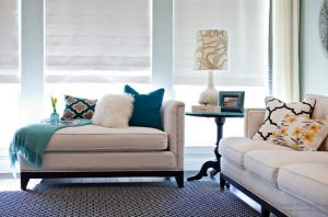 grey and yellow accent chair decorating with pillows
