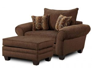 overstuffed chair and ottoman large brown lounge chair with a pair of accent pillows and an ottoman table